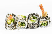 Sushi set with leawes salad and tiger shrimps — Stock Photo