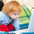 Little bright girl using laptop — Stock Photo #10608186