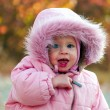 Portrait of small cute baby outdoors - Stock Photo