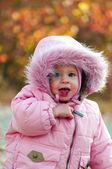 Portrait of small cute baby outdoors — Stock Photo