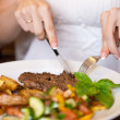 Stock Photo: Womeating in restaurant