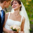 Bride and groom in the park — Stock Photo #8146753