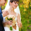 Bride and groom in the park — Stock Photo #8146757