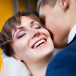 Bride smiling while groom telling her something — Stock Photo