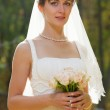 Beautiful Bride with wedding bouquet — Stock Photo #8146764