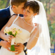 Bride and groom in the park — Stock Photo #8146783