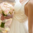 Wedding bouquet at bride's hands — Stock Photo