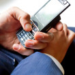 Stock Photo: Businessman hands with phone