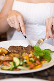 Woman eating in restaurant — Stock Photo