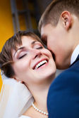 Bride smiling while groom telling her something — Foto Stock
