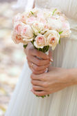Wedding bouquet at bride's hands — Stok fotoğraf