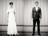 Full length portrait of bride and groom standing — Stock Photo