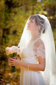 Beautiful Bride with wedding bouquet — Stock Photo