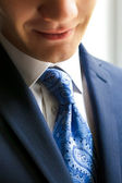 Closeup of businessman smiling — Stock Photo