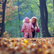 Cute little baby with mother in park — Stock Photo
