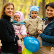 Two mothers with their babies — Stock Photo