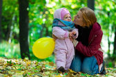 Happy young mother and her little daughter — Stock Photo