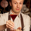 Barman with cocktail — Stock Photo