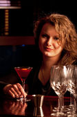 Beautiful woman at the cocktail bar — Stock Photo