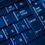 Closeup of a dark keyboard — Stock Photo