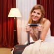 Smiling young woman in hotel — Foto de Stock