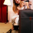 Smiling young woman in hotel — Stock Photo #9696658