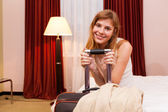 Smiling young woman in hotel — Stock Photo