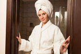 Young woman wearing a robe — Stock Photo