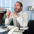 Pensive businessman - Stock Photo