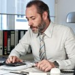 Stock Photo: Businessman calculating finance