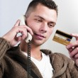 Businessmhaving conversation on telephone — Stock Photo #8177625