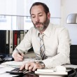 Businessman calculating finance - Foto de Stock