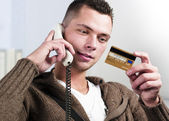 Businessman having conversation on telephone — Stock Photo