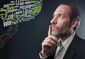 Thoughtful Businessman - business tag cloud — Stock Photo