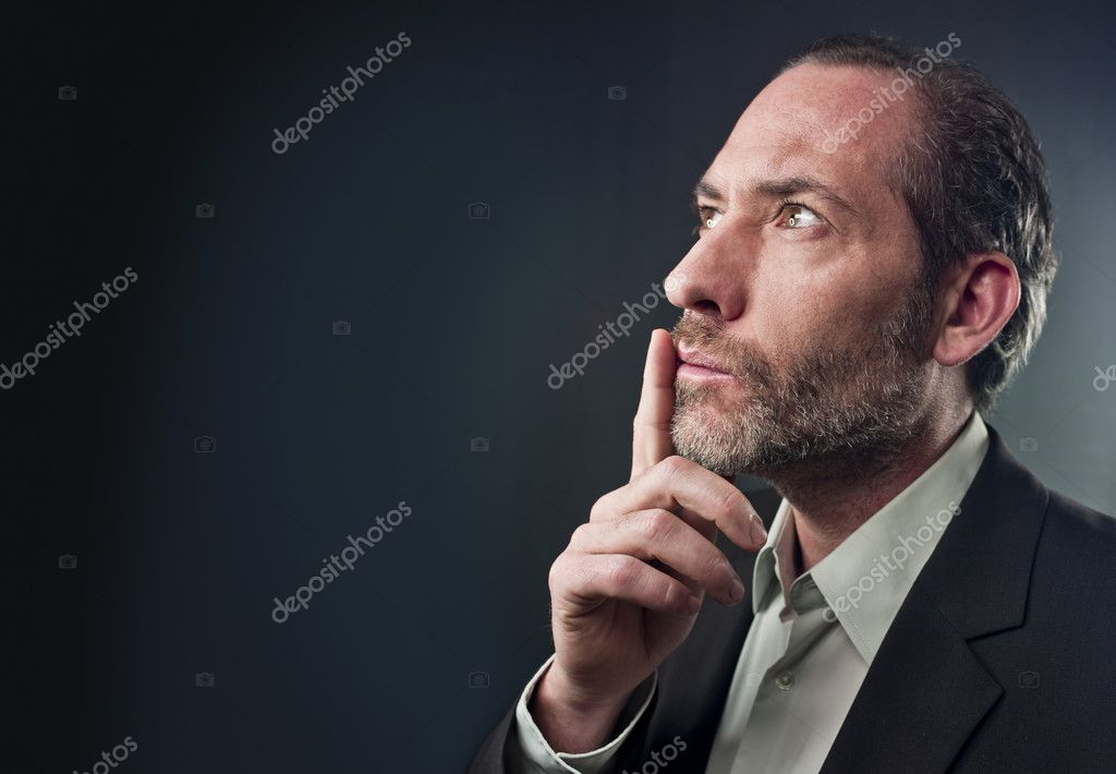 Studio shot of businessman in a deep thought over colored background (shot on PhaseOne 45) — Stock Photo #8291594