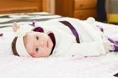 Newborn baby girl looking at camera — Foto de Stock