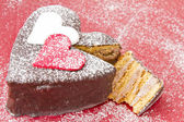 Heart shaped slice of a chocolate-cake — Stock Photo