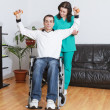 Physical therapist working with patient — Stock Photo #9860956