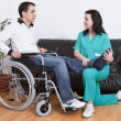 Physical therapist working with patient — Stock Photo #9860985
