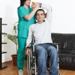 Постер, плакат: Physical therapist working with patient