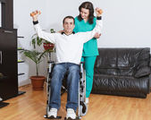 Physical therapist working with patient — Stock Photo