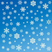 Snowflakes on blue background — 图库照片