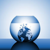 A globe sinking in water — Stock Photo