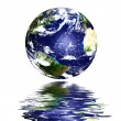 Planet earth reflected on top of water — Stock Photo #8052874