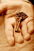 Hand with key — Stock Photo