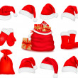 Big set of red santa hats and clothing. Vector illustration. — Stock Vector #7994351