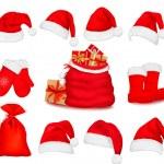 Big set of red santa hats and clothing. Vector illustration. — Stock Vector