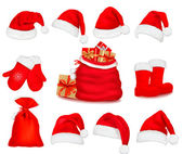 Big set of red santa hats and clothing. Vector illustration. — Vettoriale Stock