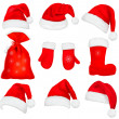 Big set of red santa hats and clothing. Vector illustration. — Stock Vector