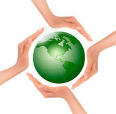 Hands holding a green earth. Vector. — Stock Vector